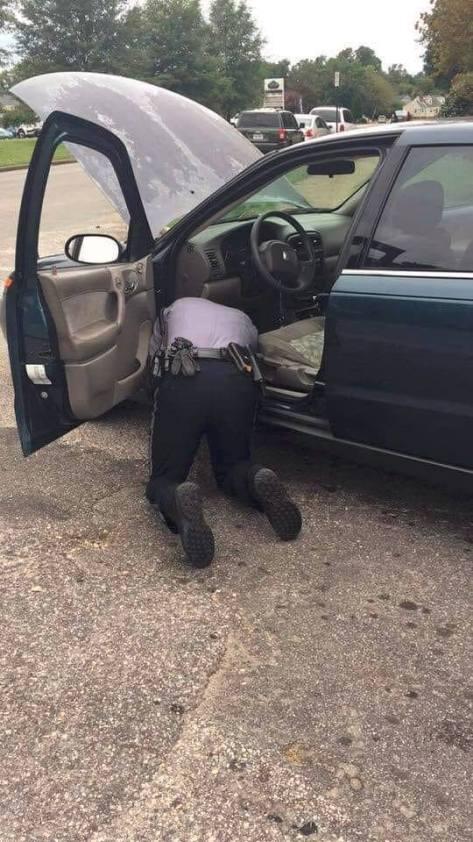 cop fixing brake light switch
